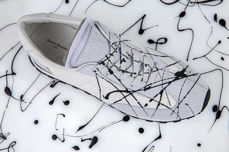 white_trainers_black_paint_splashes