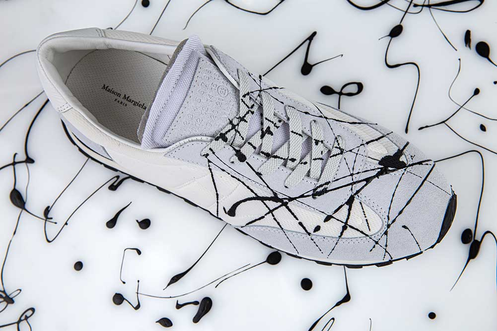 white_trainers_black_paint_splashes